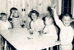 siblings. I'm the one on the left with the bowl haircut. We are raising glasses of juice for her birthday.