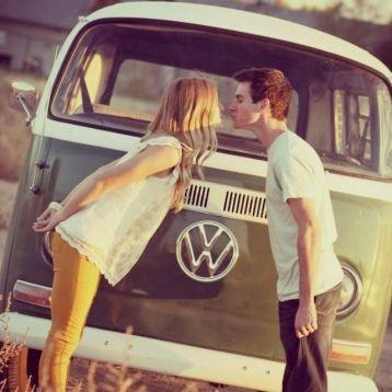 Gypsetter Couple Kissing VW Bus