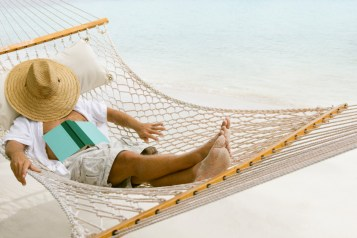 unrecognizable man relaxing in a hammock at the Caribbean beach