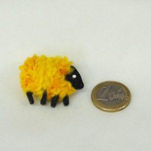 scale euro-coin yellow sheep pin