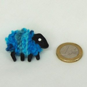 scale|euro-coin|jade|sheep|brooch