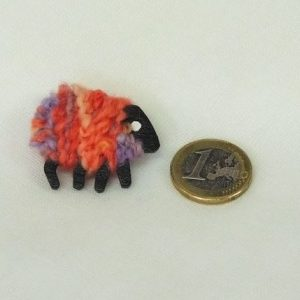 scale|euro-coin|peach|sheep|brooch