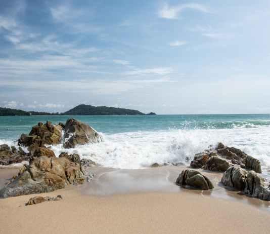 stormy sea with splashing water on rocky coast