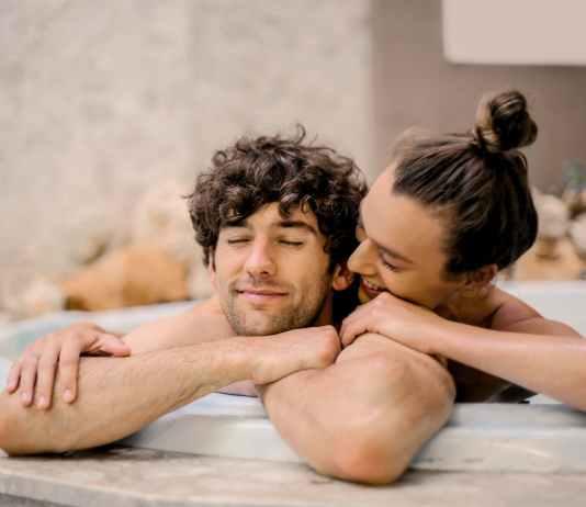 man and woman on bathtub