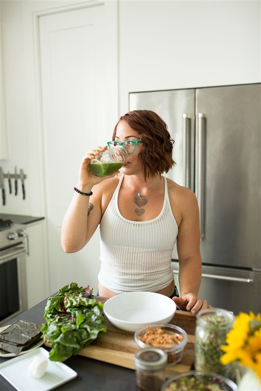 How Liver Detox Supports Weight Loss, a guest blog post on Liz in Los Angeles, Los Angeles Lifestyle Blogger | Liver Detox Weight Loss by popular Los Angeles lifestyle blog, Liz in Los Angeles: image of Amanda Montalvo drinking a green drink.