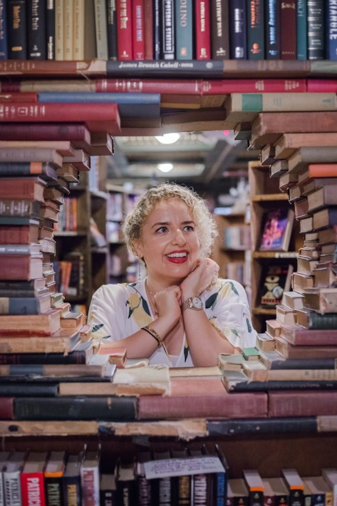 A Walkable Guide to Instaworthy Spots in DTLA y Liz in Los Angeles, a Los Angeles Lifestyle Blogger: image of a blonde women at The Last Bookstore