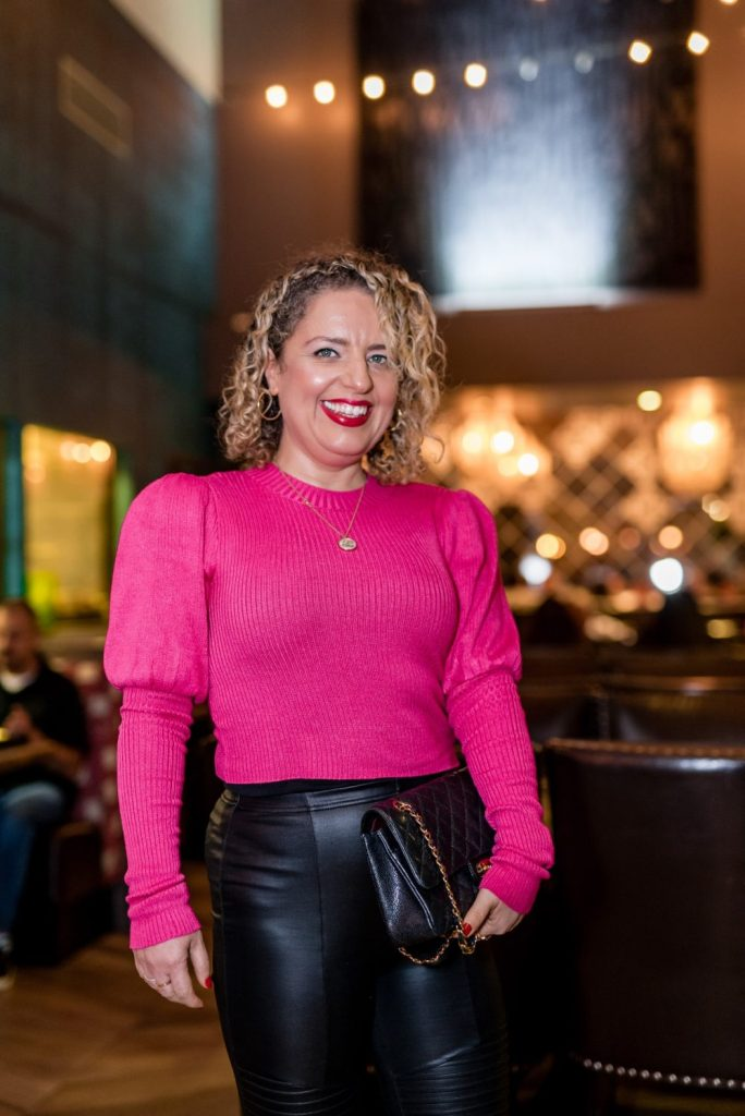 What to Wear on Valentine's Day, a blog post by Liz in Los Angeles, Los Angeles Lifestyle Blogger: an image of a blonde woman wearing a pink sweater and leather leggings