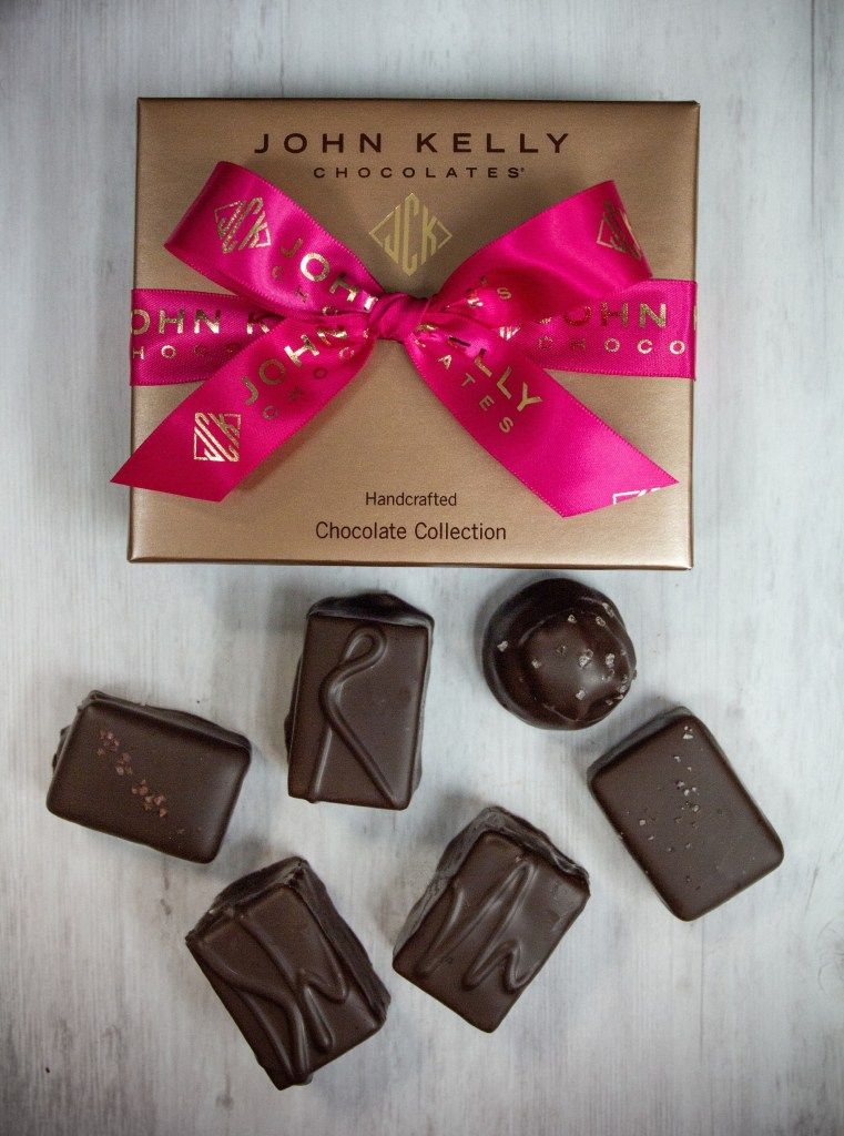 Top Things to Do in LA in February, a blog post by Liz in Los Angeles, Los Angeles Lifestyle Blogger: an image of chocolates and a chocolate box with a ribbon on it