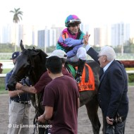 Elvis Trujillo with Itsmyluckyday (KY) before entering the winners' circle