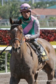 Emollient (KY) with jockey Jose Lezcano on board returning from the Gulfstteam Oaks G2