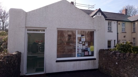 Village launderette hiding behind community notices