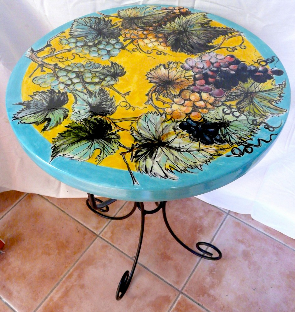 Vineyard. Summer Al Fresco. Ceramic table with wrought iron legs. A very strong and durable table for outdoor or indoors.   52.5cms high 71cms diameter. 2006© FOR SALE.. Enquiries to lizmooregolding@gmail.com Commission me to paint your design!
