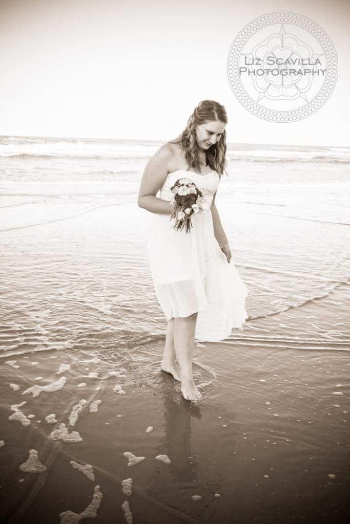 Bride walking along beach