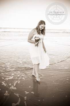 Bride walking along beach