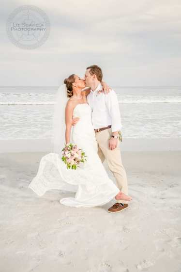 Groom Kissing Bride on Beach