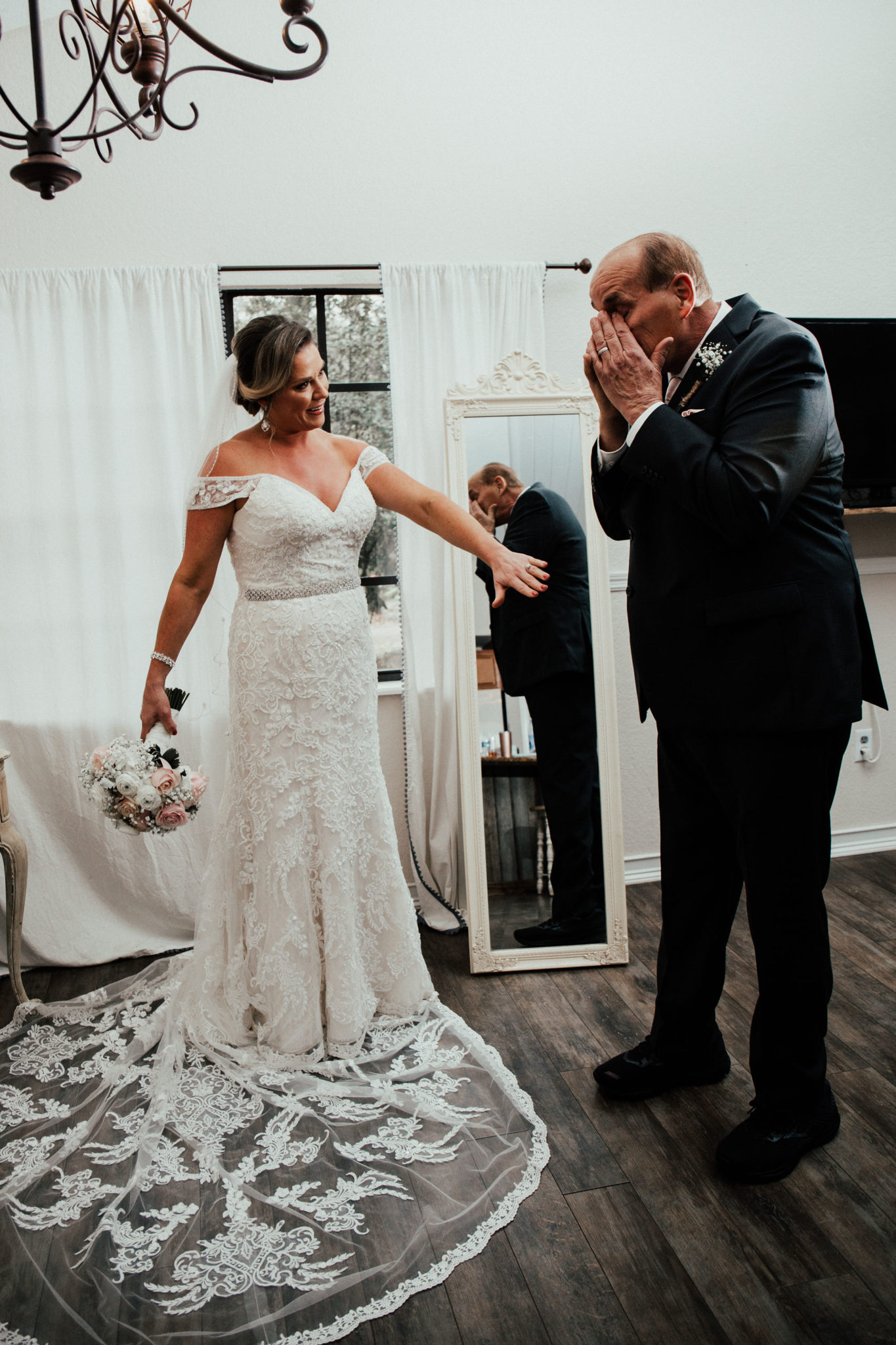 An emotional first look with the father of the bride.