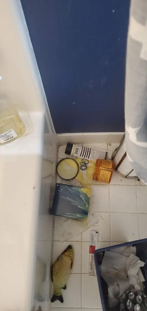 spilled lotion on bathroom floor