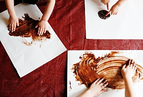 Lizzie Homemaker Finger painting with chocolate pudding