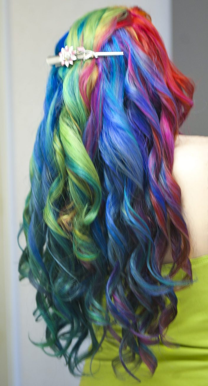 Long rainbow colored hair in curls.