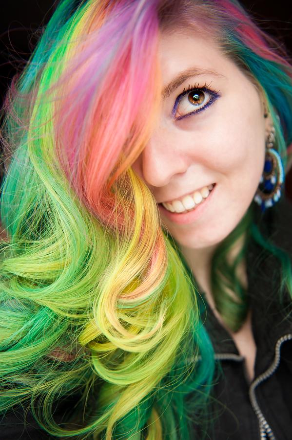 Luscious curled pastel rainbow hair on Lizzy Davis.