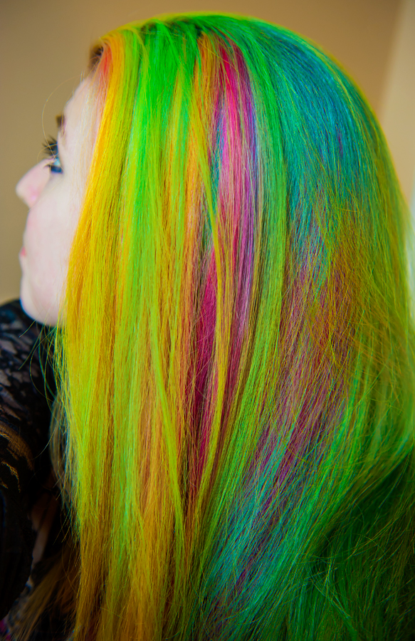 Vibrantly streaked rainbow hair on Manic Panic dye hard Lizzy Davis.