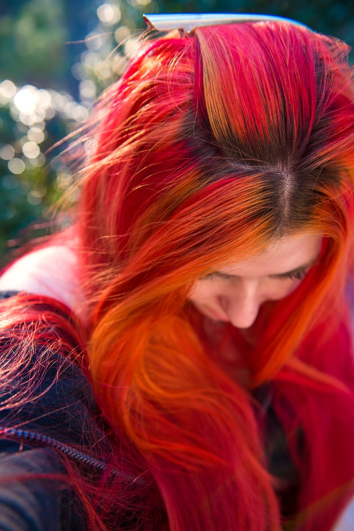 Bright red and orange hair on Lizzy Davis. Manic Panic Psychedelic Sunset and Manic Panic Vampire Red.