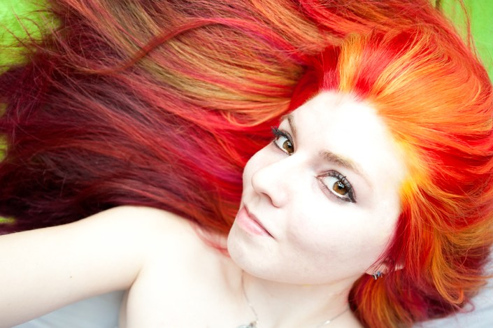 Vibrant yellow, orange and red fire hair.