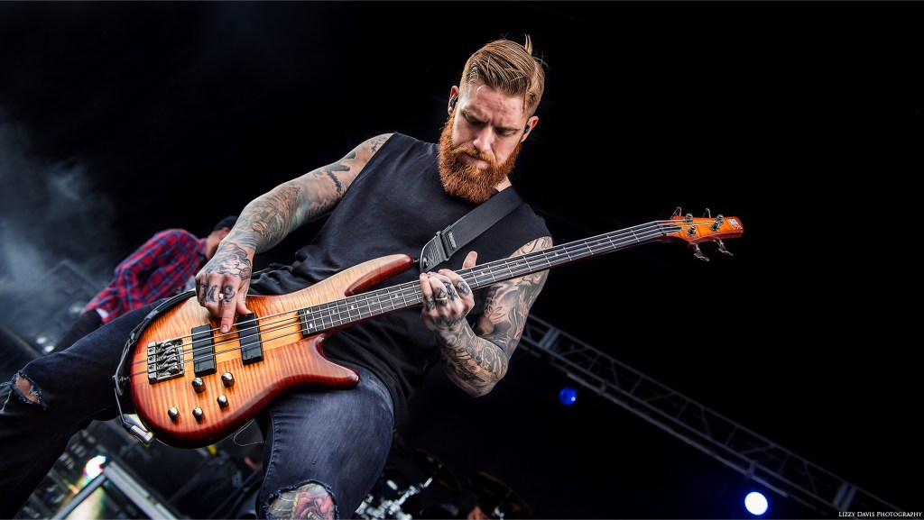 Bryce Paul, current live touring bassist of metal band In Flames. Carolina Rebellion photos by ©Lizzy Davis Photography.