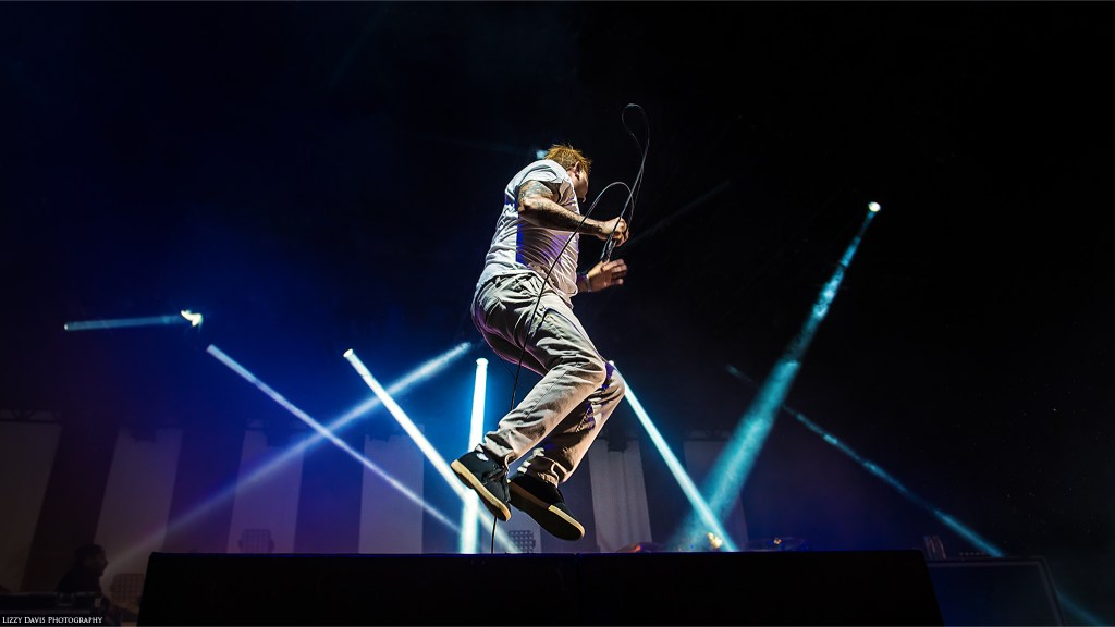 Photo of Chino Moreno jump on stage. Deftones photos by ©Lizzy Davis Photography.