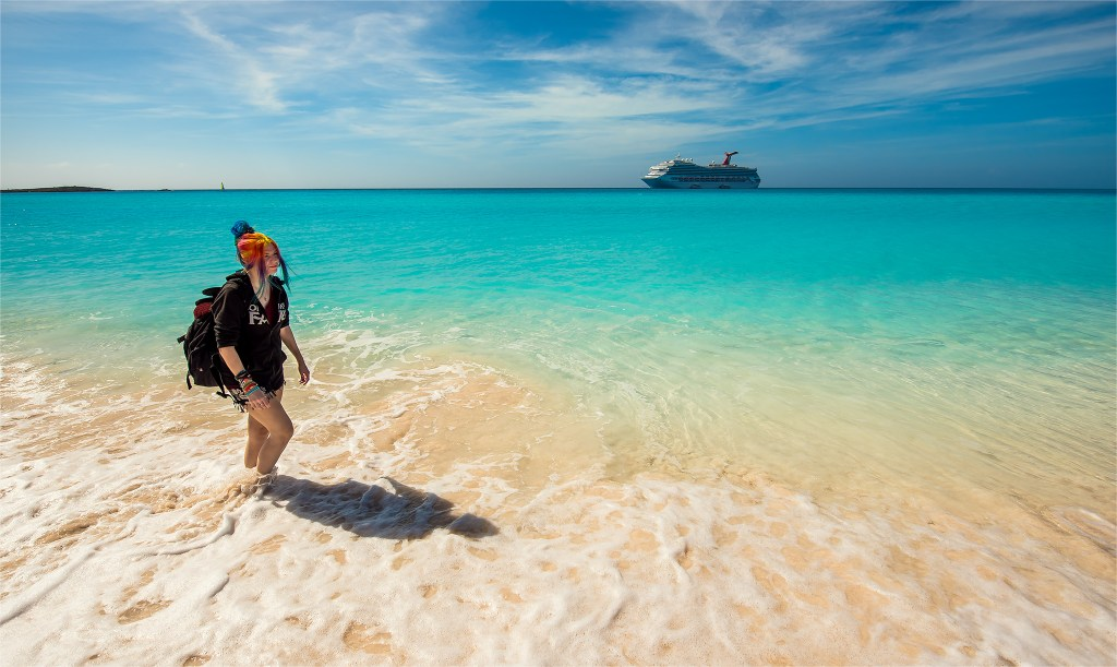 Rainbow hair taking a walk down Half Moon Cay with Carnival Liberty in the background. Beach photos by Trevor Williams Photography.