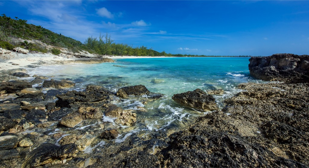 Rocky beach at the end of Half Moon Cay. Bahamas travel photos by Lizzy Davis.