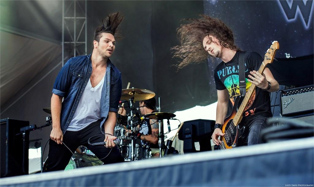 Rick DeJesus and Andrew Cushing of Adelitas Way share an energetic headbang moment at Louder than Life.