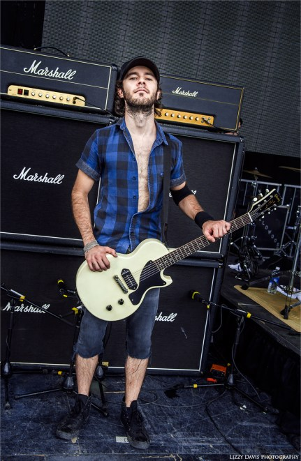 Adelitas Way guitarist Robert Zakaryan poses with Marshall Amp stack and his prized Gibson guitar.
