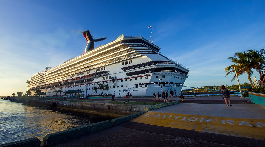 Photo of the Carnival Liberty cruise ship docked at port in Nassau, Bahamas by Lizzy Davis Photography.