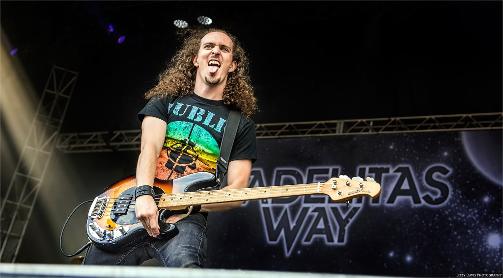 Andrew Cushing, bassist of Adelitas Way sticks his tongue out to the crowd at Louder Than Life 2016.