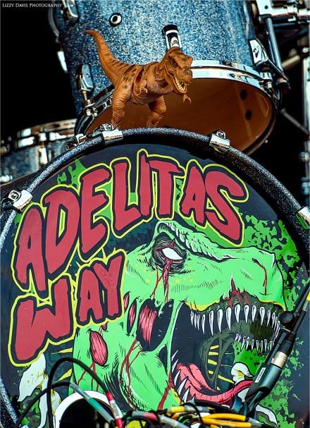 Adelitas Way branded drum head with T-Rex mascot!