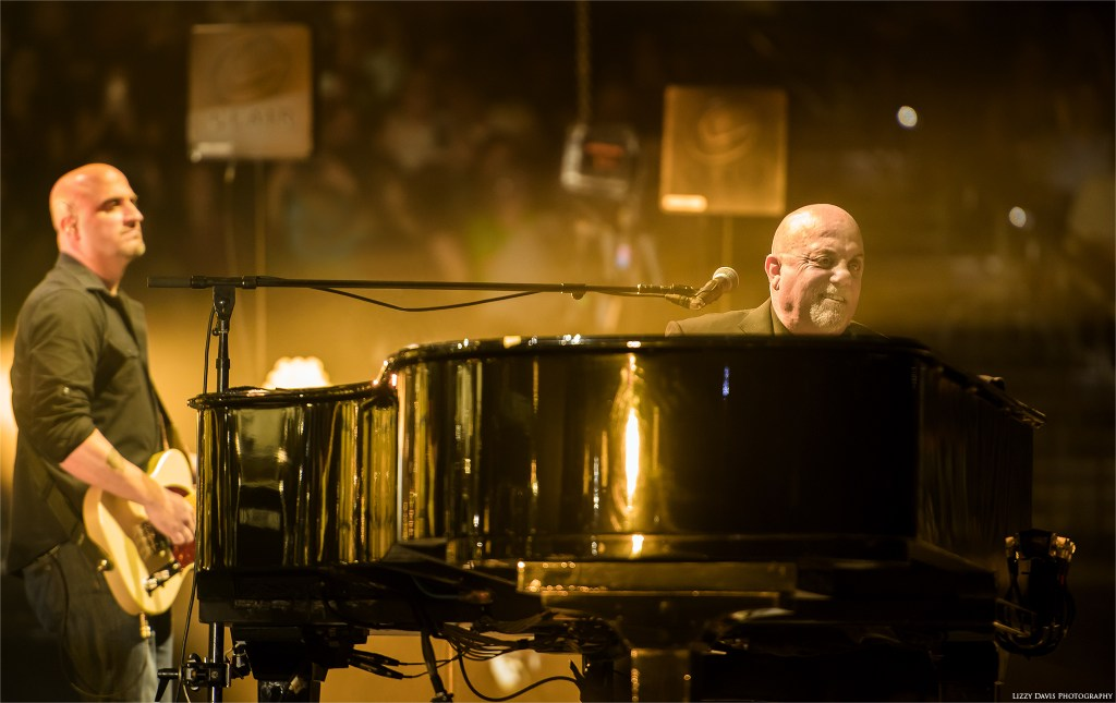 Billy Joel smiling at the crowd in Tampa. Concert photos by Lizzy Davis.