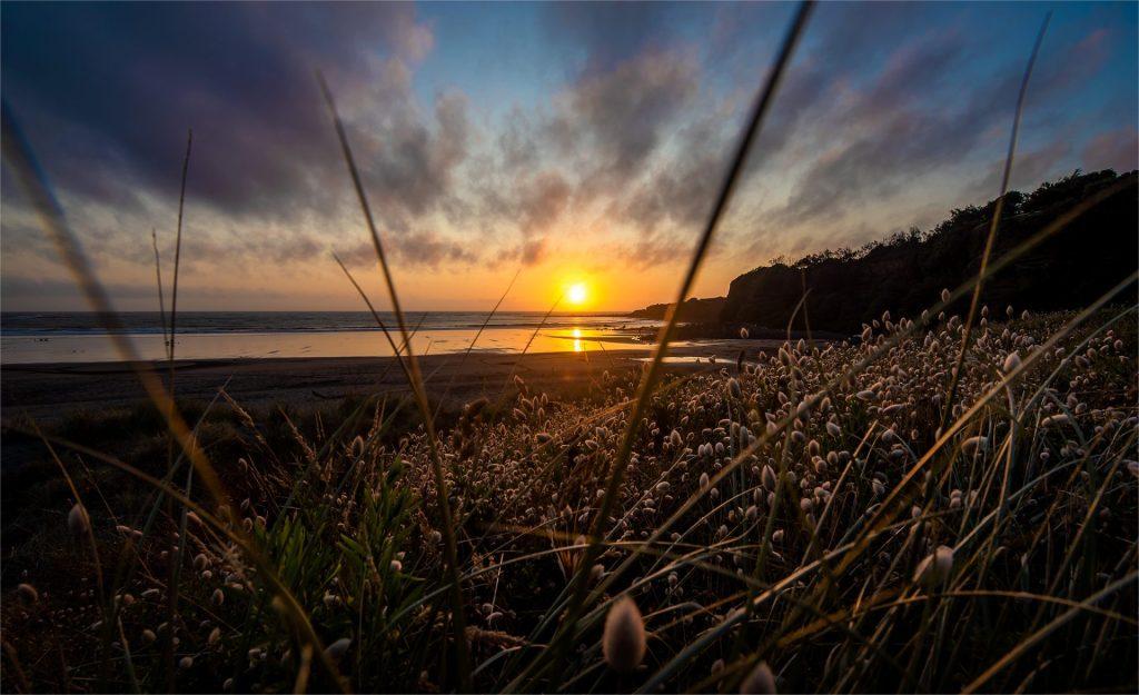 New Zealand sunset over Opunake Beach. | Landscape photos by Lizzy Davis.