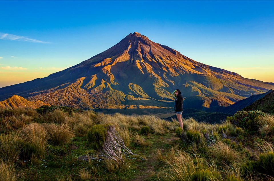 Landscape photographer Lizzy Davis pictured with Mount Taranaki in New Zealand.