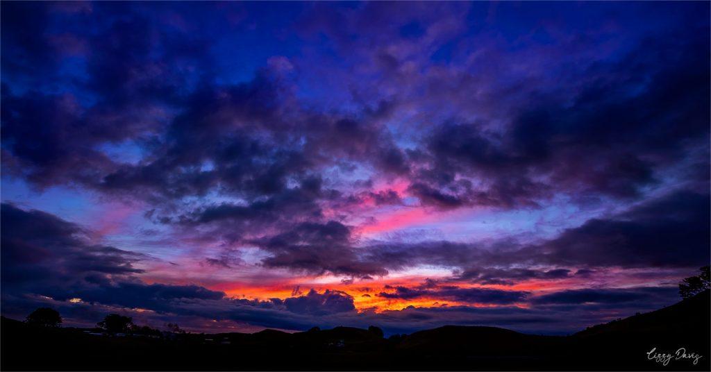 New Zealand sunset in Taranaki region by Lizzy Davis Photography.