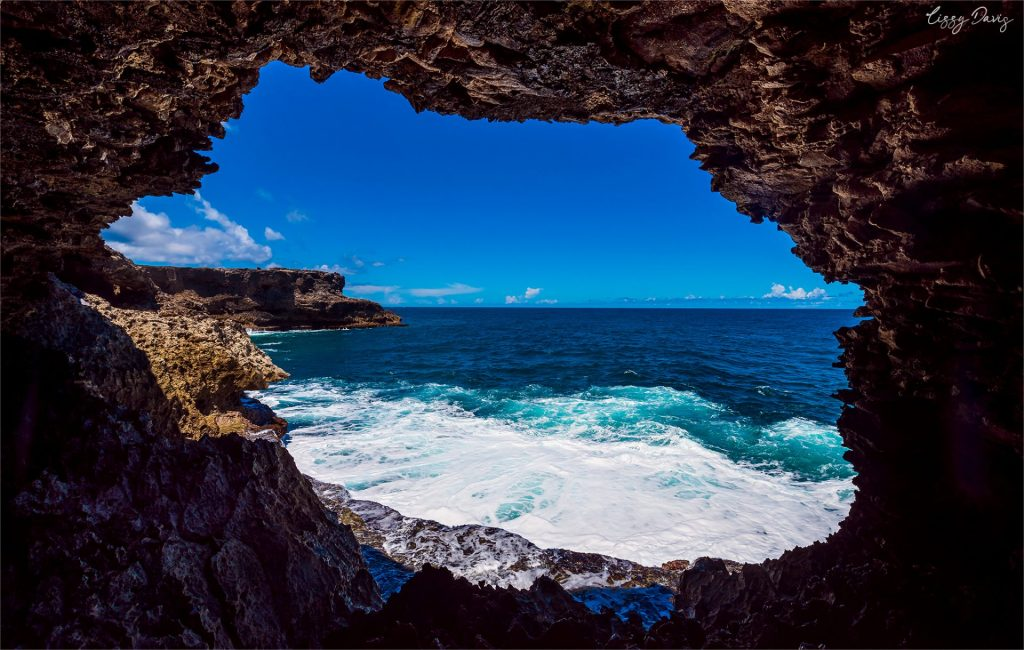 Looking at the northernmost point of Barbados through a cave window inside the Animal Flower Caves.