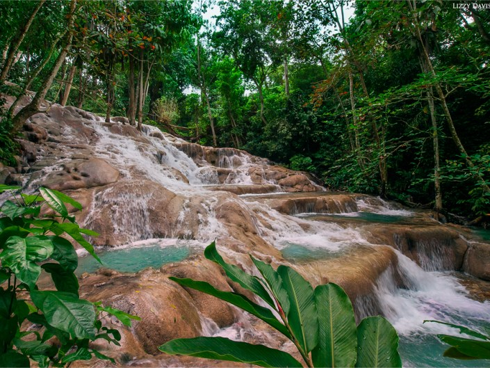 Incredible Dunn's River Waterfalls in Ocho Rios, Jamaica. Landscape photography by Lizzy Davis.