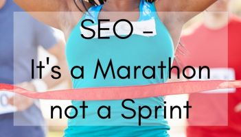 SEO copywriting - image of a black woman crossing the finish line having won the race. her arms are in the air and she's smiling widely