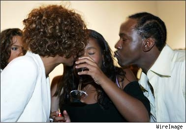 Whitney,Bobbi Kristina drinking out of a wine glass...and Bobby Brown.Strong parental influences apparently!!!