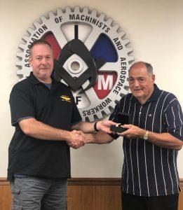 Bill Clingenpeel receives a retirement watch from President Howard Ferguson