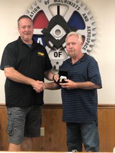 Chuck Heiser receives a retirement watch from President Howard Ferguson