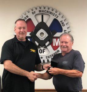 James Ostapchenko receives a retirement watch from President Howard Ferguson