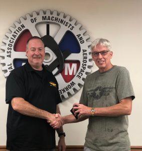 Mark Maurer receives a retirement watch from President Howard Ferguson