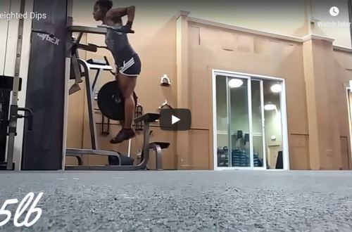 woman doing weighted dips