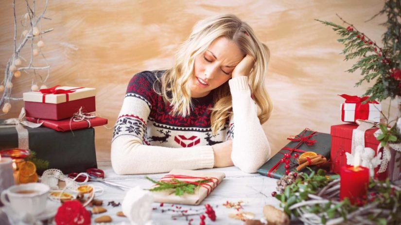woman gift wrapping tired.jpg
